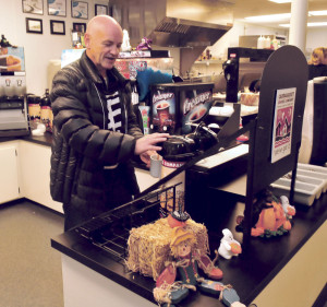 Customer James Pryor loads up on coffee before his breakfast at the Toast XPress diner in Waterville on Thursday.