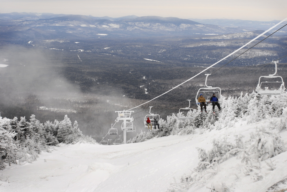 Skiers ride the new Kennebago Quad chair lift at Saddleback Mountain in 2008. Owners had suggested the area wouldn't open for the 2015-16 season uniless they could get the money to replace another lift at the area, but now say they may have a buyer for the resort.
