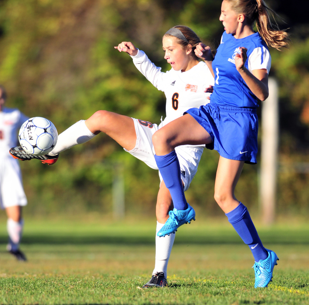 Staff photo by Joe Phelan   Gardiner striker Anna Chadwick kicks the ball past Morse's Ella Martin during a Class B game Thursday in Gardiner.
