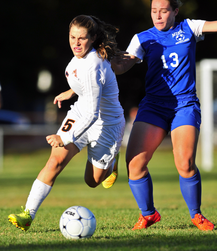 Staff photo by Joe Phelan   Gardiner striker Lauren Chadwick, left, battles for the ball with Morse's Hope Faulkingham during a Class B game Thursday.