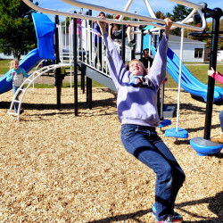 Makayla Wallingford plays on new equipment at Canaan Elementary School on Thursday. Two years in the making, the playground is also open to the community at large.
