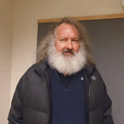In a photo provided by the Vermont State Police, actor Randy Quaid stands in the Vermont State Police barracks in St. Albans, Vermont, on Friday.