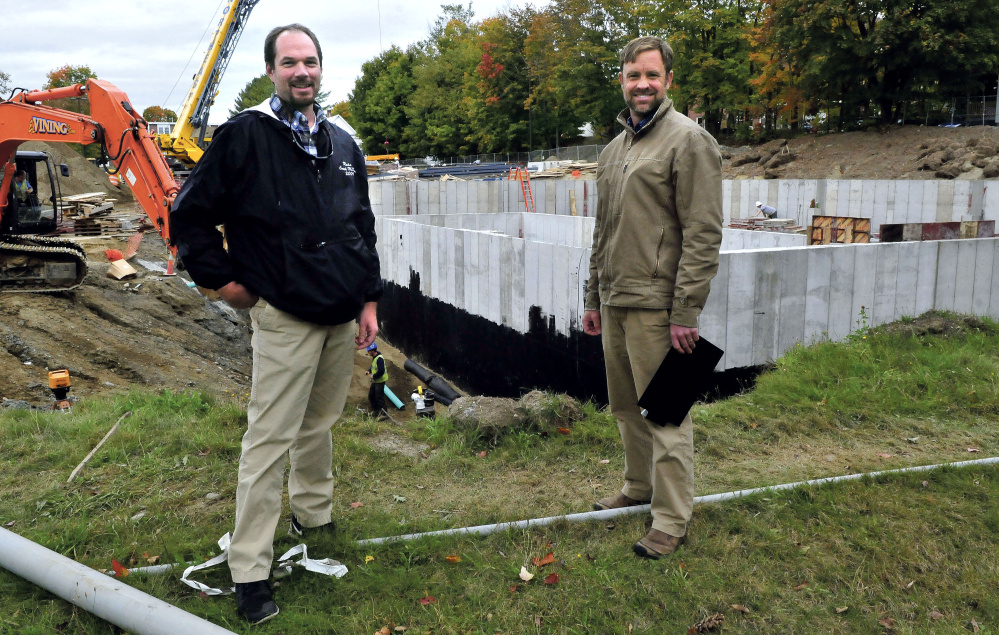 Jeff McKay, left, director of facilities management at the University of Maine at Farmington, and Luke Kellett outside the biomass central heating plant site near the campus in Farmington.