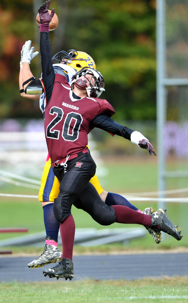 Nokomis High School's Colby Penette (20) breaks up a pass intended for Mt. Blue High School's Zach Meader (22) on Saturday in Newport.