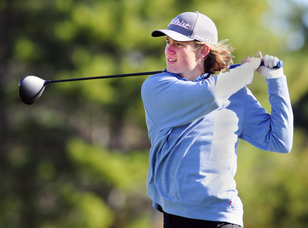 Messalonskee's Dylan Burton tees off on the third hole of Tomahawk during the state team golf tournament Saturday at Natanis Golf Club in Vassalboro.