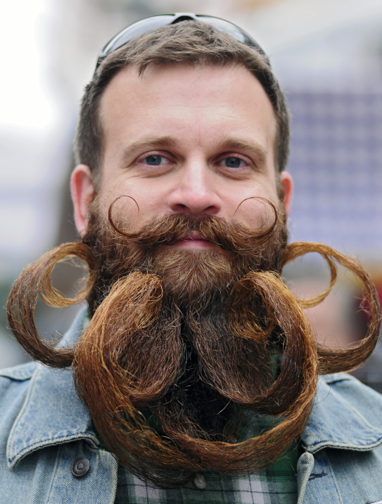 Bryce Royal, of Windham, competes in the beard contest during the Swine and Stein festivities on Saturday on Water Street in downtown Gardiner.