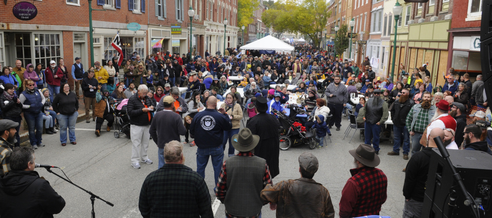 Competitors stand before judges during the Swine and Stein festivities on Saturday on Water Street in downtown Gardiner.