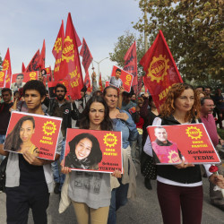 Protesters carry pictures of people killed in Saturday's bombing attack during a march in Ankara, Turkey, on Sunday. Turkey declared three days of mourning following Saturday's nearly simultaneous explosions that targeted a peace rally in Ankara.