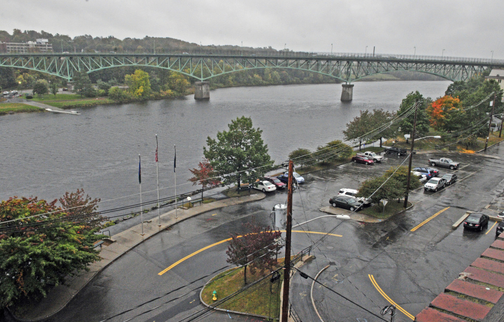 The scenic view of the Kennebec River in downtown Augusta is seen through the back windows of 287 Water St. on Friday.