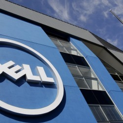 In this Tuesday, Aug. 21, 2012, file photo, the sun is reflected in the exterior of Dell Inc.'s offices in Santa Clara, Calif.