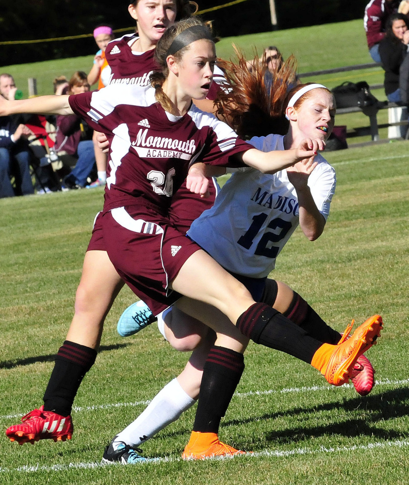 Monmouth's Emily Grandahl. left, and Madison's Ashley Emery clash during a game Monday in Madison.