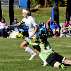 Madison's Kayla Bess goes after the ball as Monmouth keeper Mikayla Cameron defends Monday in Madison.