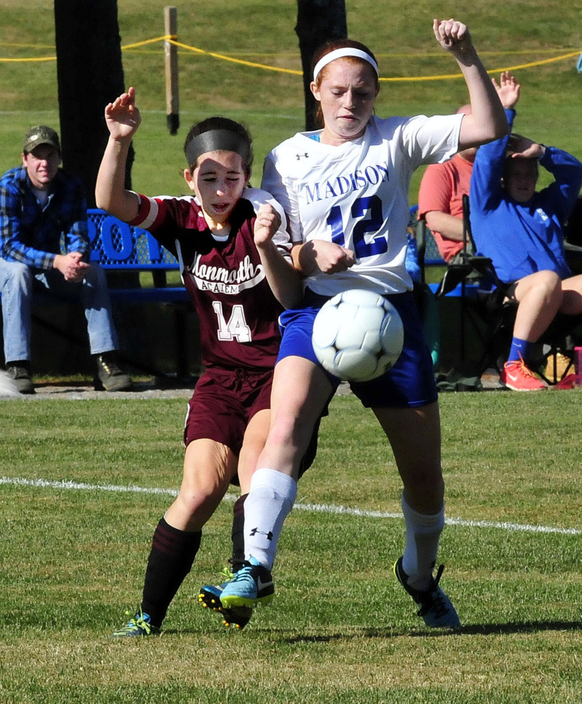Monmouth's Taylor Spadafora and Madison's Ashley Emery collide while going for the ballMonday in Madison.