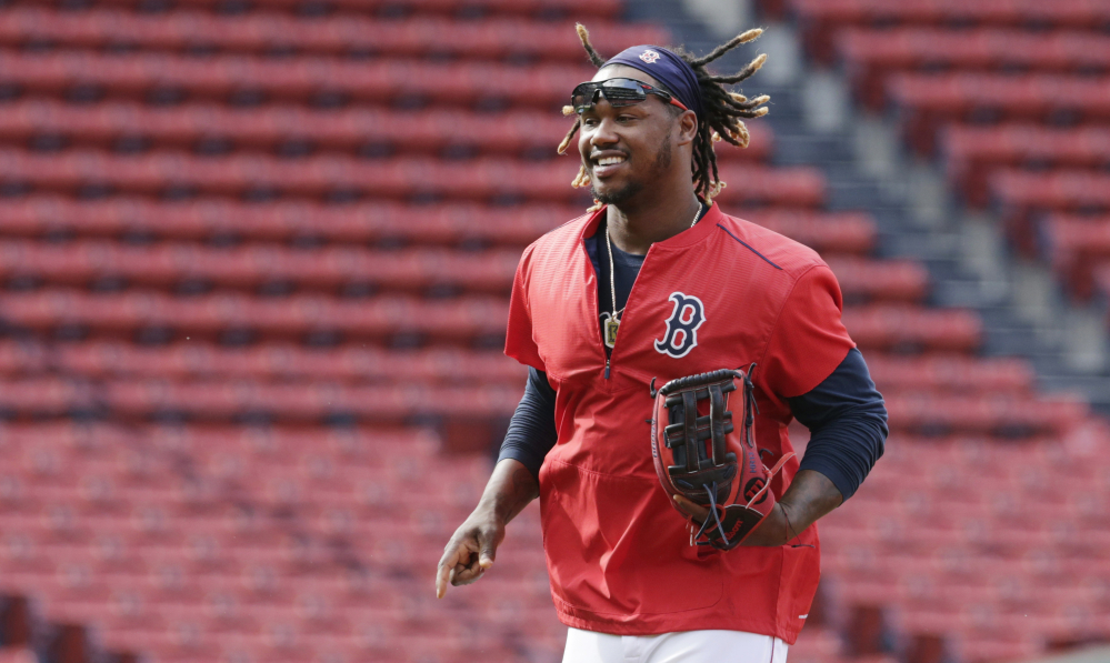 AP photo   In this July 7 file photo, Boston Red Sox outfielder Hanley Ramirez runs across the infield at Fenway Park in Boston.  New Boston Red Sox boss Dave Dombrowski says the team is committed to playing Hanley Ramirez at first base next season. Dombrowski says Ramirez and his representatives are also on board with the plan.