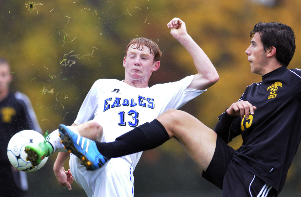 Staff photo by Andy Molloy   Maranacook's Carlo Bozzola, right, goes foot-to-foot with Erskine's Brock Glidden during a Class B game Tuesday in South China. Maranacook won, 2-1.