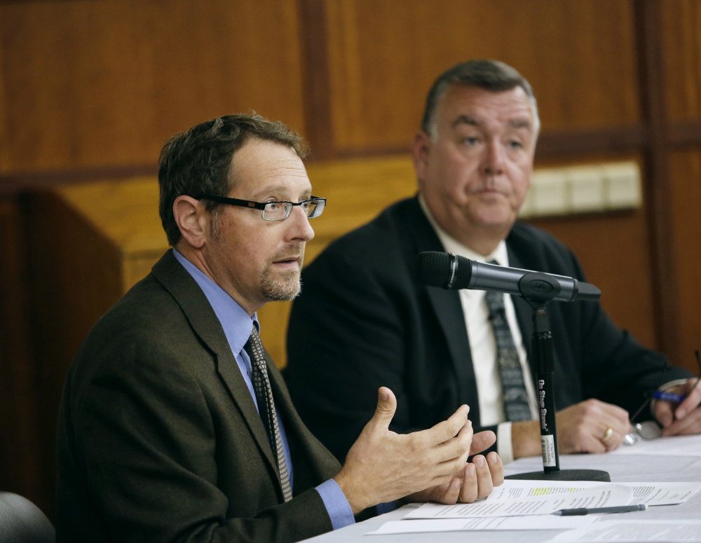 Dr. Chris Pezzullo, left, chief health officer, and Kenneth Albert, director and chief operating officer, of the Maine Center for Disease Control and Prevention , discuss the role that immunizations play in disease control and prevention, the public health immunization law and policy, and the tension between such law and personal autonomy.