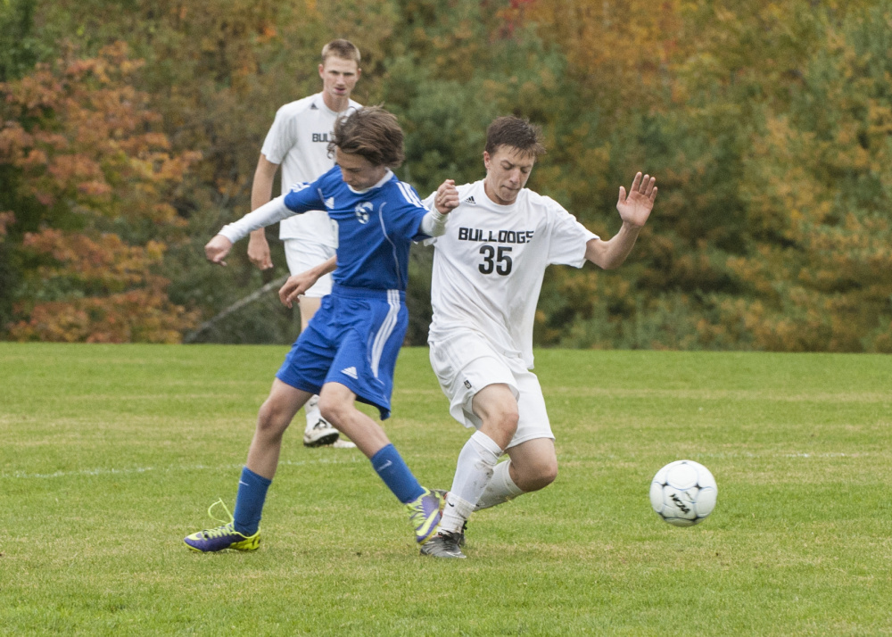 Contributed photo/Marty Thornton Hall-Dale's Jett Boyer tries to shake off Mt. Abram's Tor Tooker during a Mountain Valley Conference game Tuesday in Farmingdale.