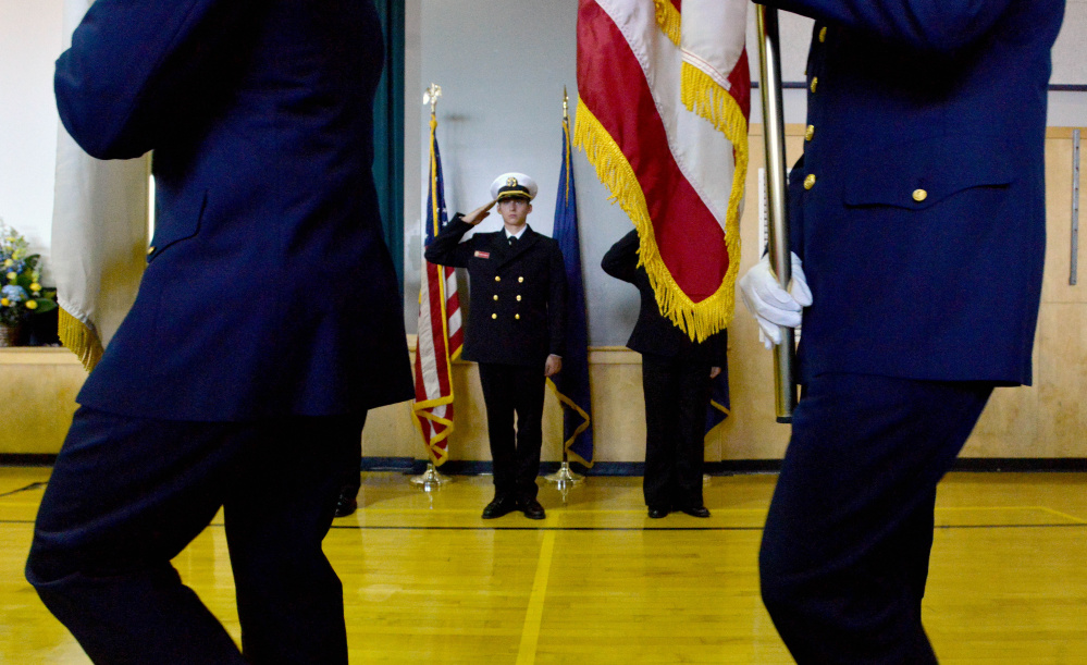 Members of the U.S. Coast Guard color guard march into the Jay Community Building with the American flag during a celebration of Michael Holland's life on Wednesday.