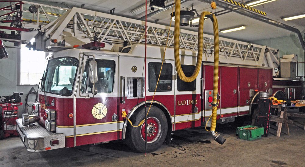 Augusta's disabled ladder truck is parked in the Western Avenue station in this April file photo.