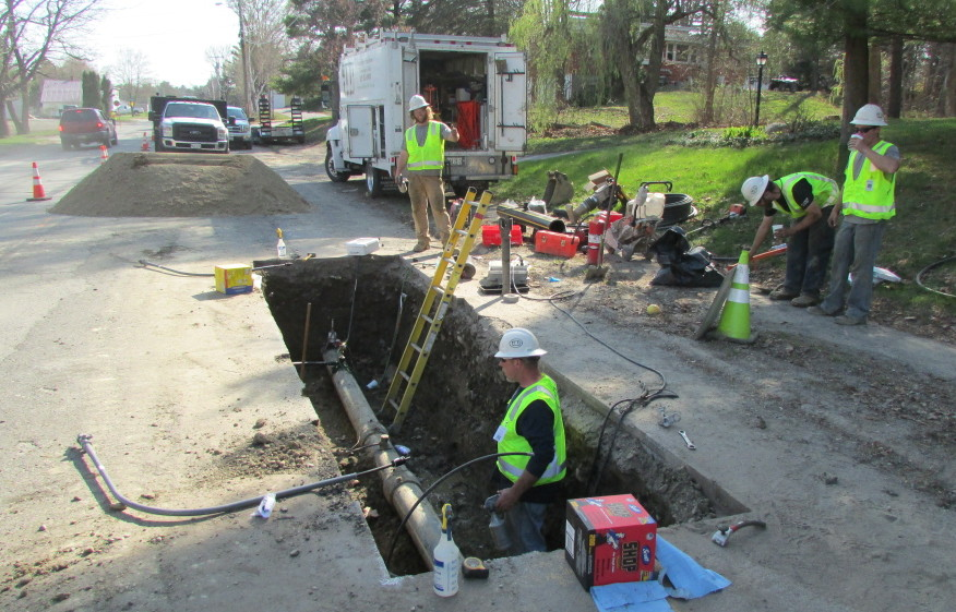 Employees from ETTI, a utilities construction company from Lisbon Falls, replace an electrofusion tee on a Summit Natural Gas line in April on Cool Street in Waterville. Summit has been ordered by state regulators to inspect hundreds additional pipeline connections that may be faulty.