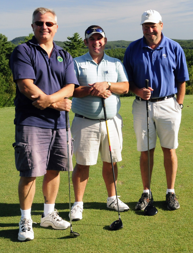 First place net was won by the Mayberry Builders threesome, from left, are Zlatko Necevski, Alex Gaeth and David Mayberry.