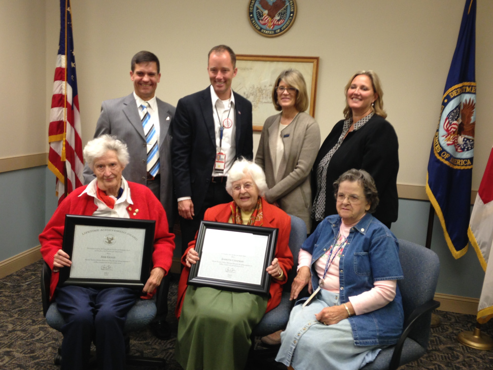 Ann Guild, front left, and Jeannette Chapman display the President's Lifetime Achievement Award recognizing them for 95 years of combined volunteer service to the American Red Cross at Maine VA Medical Center. The Red Cross honored the women Thursday during a ceremony at the medical center that included, back row, left to right, retired U.S. Air Force Col. Eric Gates, manager of Services to the Armed Forces for the Red Cross; Ryan Lilly, director of the Maine VA Healthcare System; Patricia Murtagh, CEO of the American Red Cross in Maine; April Caron, executive director of the American Red Cross of Central and Mid Coast Maine; and Ellie Mills, front right, who has volunteered for the Red Cross at the medical center for the past four years.
