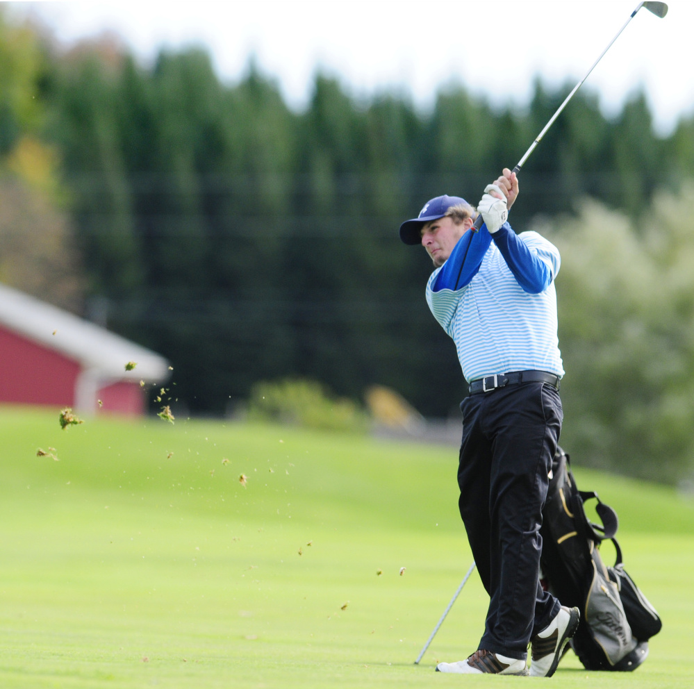 Staff photo by Joe Phelan   Messalonskee's Billy Rollins hits a shot from the fairway of the third hole on Natanis' Tomahawk Course during the team state championships last Saturday.