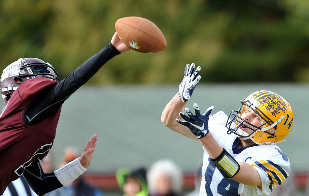 Staff photo by Michael G. Seamans   Mt. Blue wide receiver Nate Pratt-Holt tries tro haul in a pass in front of Nokomis defender Isaac Thibodeau during a Pine Tree Conference Class B game last Saturday. Pratt-Holt and the Cougars host Brunswick on Friday in a key PTC B showdown.