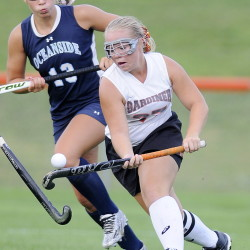 Staff file photo by Andy Molloy   Gardiner Area High School's Nickyia Lovely dribbles past Oceanside's Clara Feltus during a field hockey game Sept. 3 in Gardiner. The Tigers open the Class B North playoffs as the No. 1 seed.