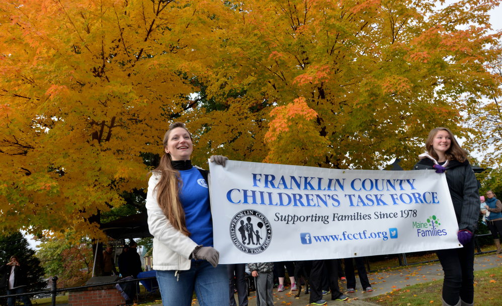 Stacie Bourassa, left, and her daughter Anna, 13, lead a fundraising walk benefiting child-abuse prevention education and resources Saturday in Farmington.