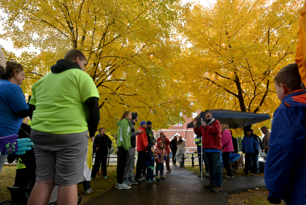 Doug Saunders, right center, addresses the crowd before a fundraising walk hosted by the Franklin County Children's Task Force on Saturday in Farmington to support child-abuse prevention programs.