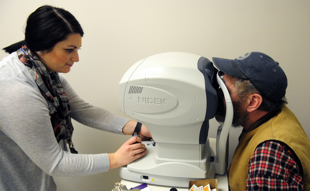 Marie Mantelli, left, does an eye examination of Rob Gaston, of Waldoboro, during the 18th annual Homeless Veterans Stand Down on Saturday VA Maine Healthcare System-Togus.