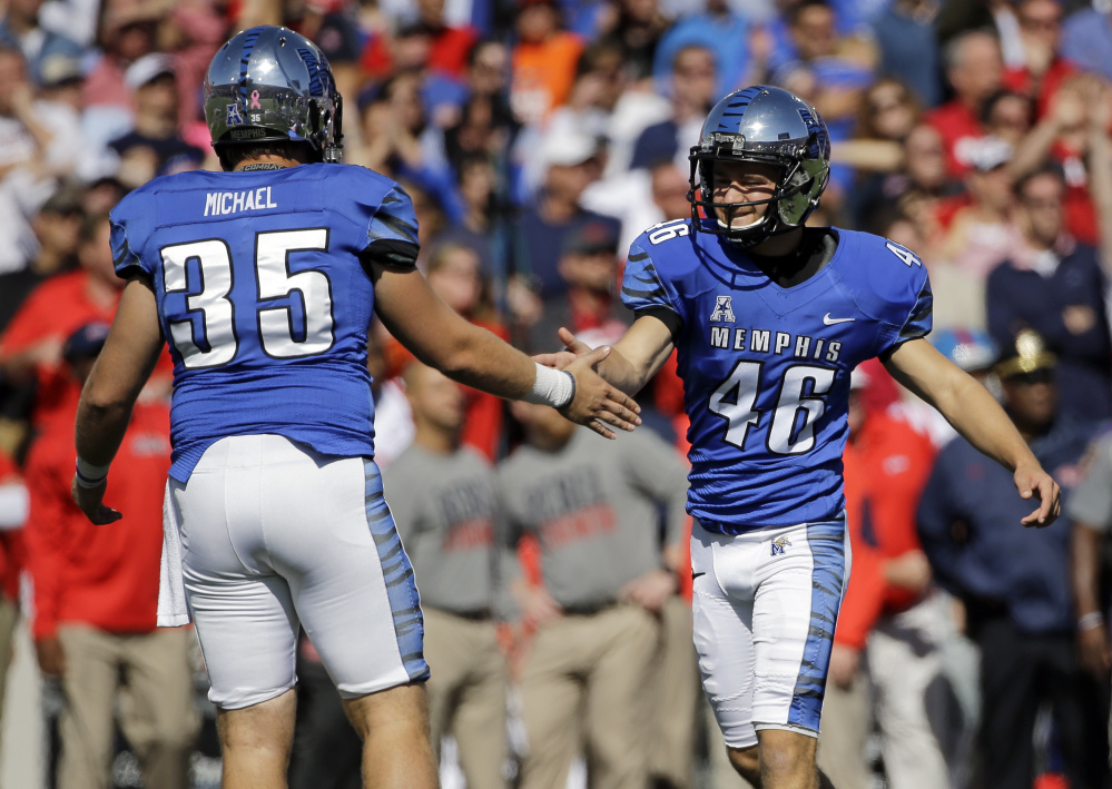 Memphis place kicker Jake Elliott (46) is congratulated by holder Evan Michael (35) after Elliott kicked a 27-yard field goal against Mississippi in the second half Saturday in Memphis, Tenn. Memphis upset No. 13 Mississippi 37-24.