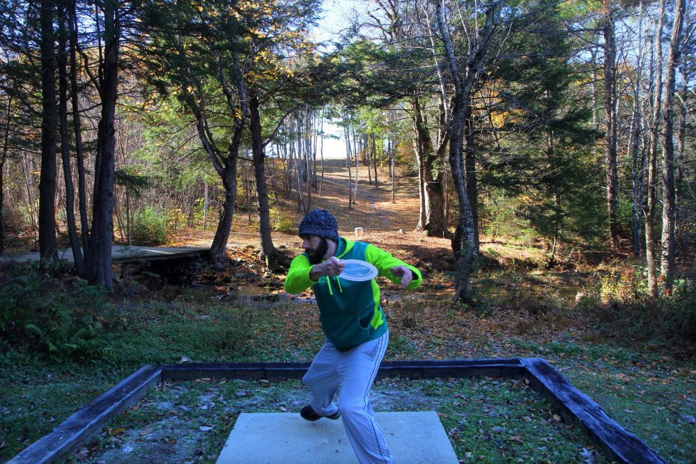 Byron Philbrook of Scarborough tees off on No. 18 during the 2nd annual Porcupine Ridge PDGA Open on Sunday in Augusta.