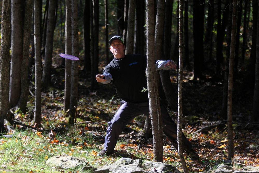 Matt Enman of Orrington makes his second throw on the par 3 No. 12 hole during the 2nd annual Porcupine Ridge PDGA Open at Porcupine Ridge on Sunday in Augusta.