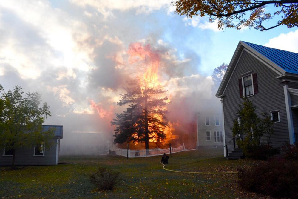 Firefighters respond to a barn fire in Bingham on Sunday afternoon.