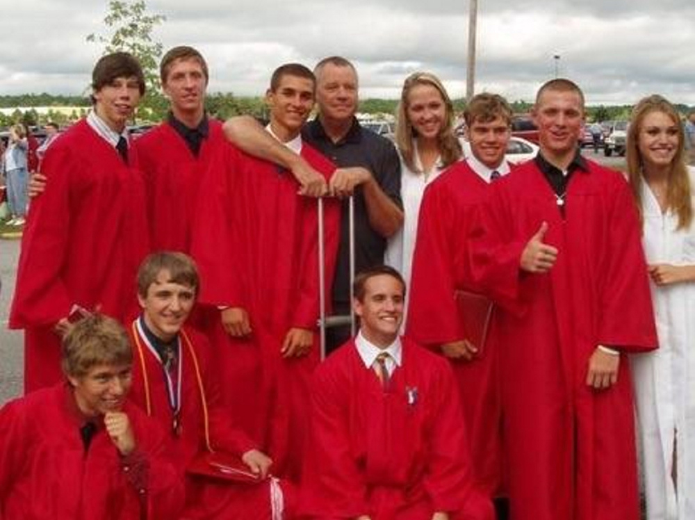 Contributed photo/Harmon family   Taylor Harmon, back, poses with members of the 2010 Cony High School graduating class. Harmon, a longtime Cony indoor track and field coach and supporter of student-athletes, died Sunday. He was 70.