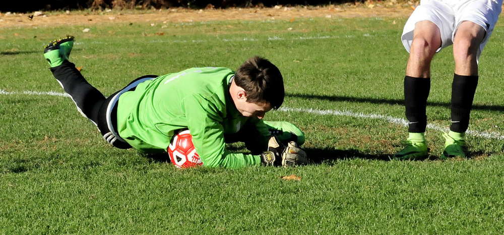 Carrabec keeper Trent Richardson comes up with a save during a Mountain Valley Conference game against Hall-Dale on Monday in North Anson.