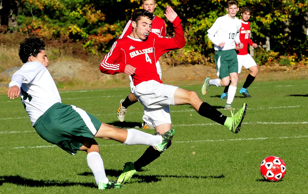Carrabec's Paul Kaplan, left, and Hall Dale's Tyler Nadeau try to get a leg up during a Mountain Valley Conference game Monday afternoon in North Anson. Nadeau's goal with 21 minutes left was the difference as Hall-Dale prevailed 1-0.