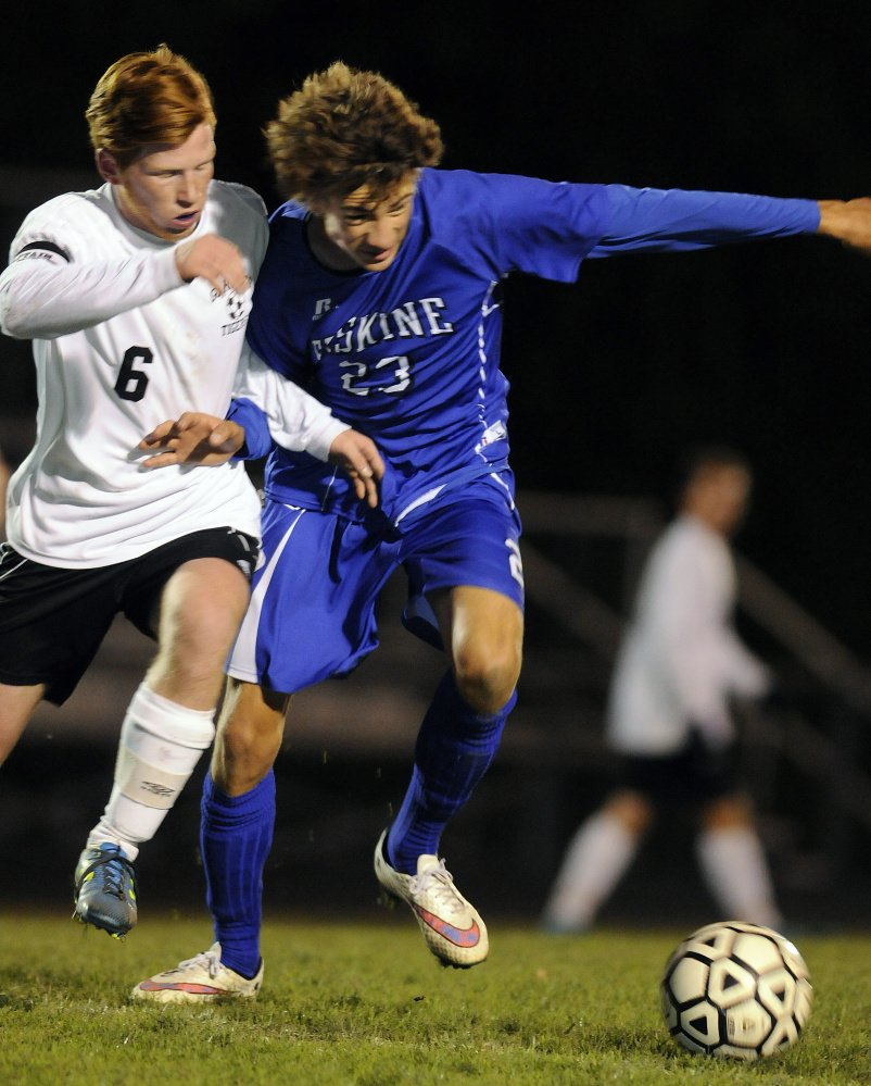 Staff photo by Andy Molloy  Gardiner's Peter Del Gallo, left, battles Erskine's Grayson Petty for possession during a Kennebec Valley Athletic Conference Class B game Monday night in Gardiner. The Eagles won, 4-2.