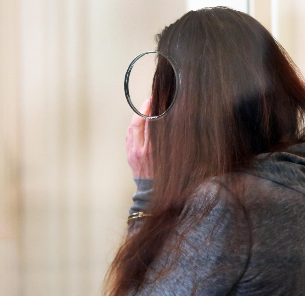 """Rachelle Bond attends a hearing Tuesday in Dorchester District Court in Boston. Bond is charged with being an accessory after the fact in helping to dispose of the body of her daughter, Bella, the girl dubbed """"Baby Doe."""" Her boyfriend, Michael McCarthy is charged with murder in the case."""