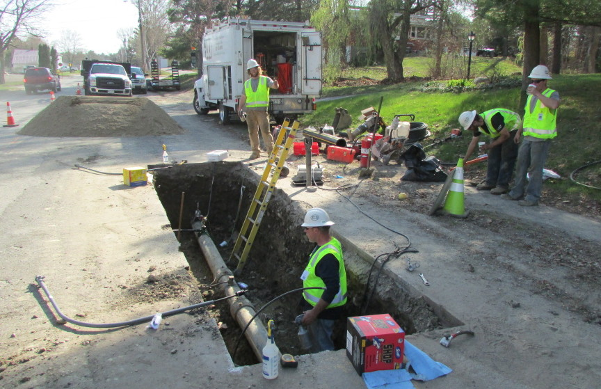 Employees from ETTI, a utilities construction company from Lisbon Falls, replace an electrofusion tee on a Summit Natural Gas line in April on Cool Street in Waterville. Summit has been ordered by state regulators to inspect and replace hundreds additional pipeline connections that may be faulty in several communities, including in Waterville.