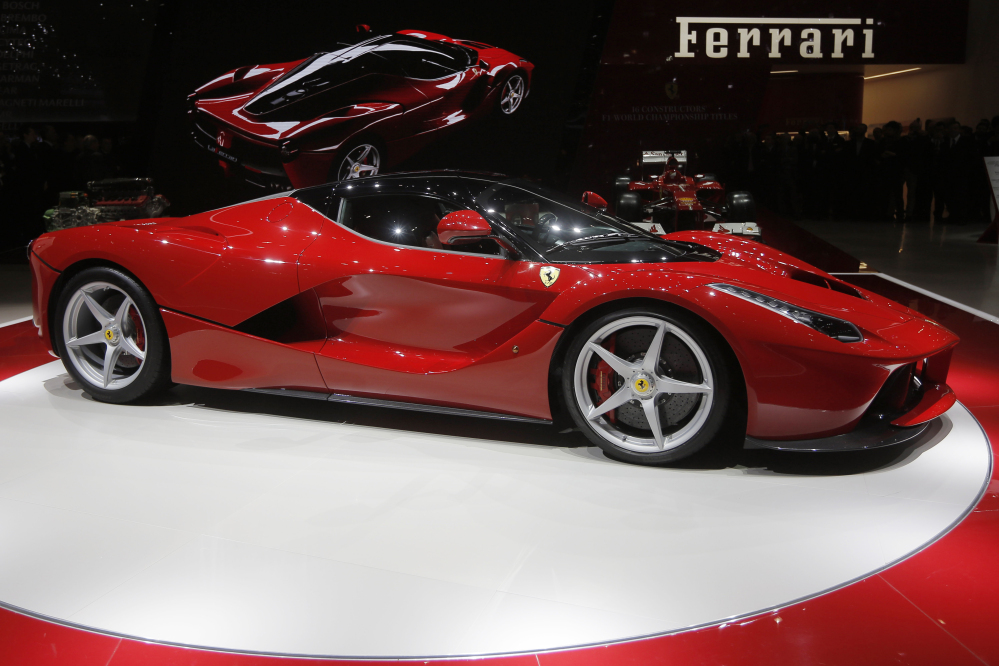 In this March 5, 2013 file photo, the new Ferrari, named LaFerrari, is presented during the first media day of the 83rd Geneva International Motor Show, Switzerland.