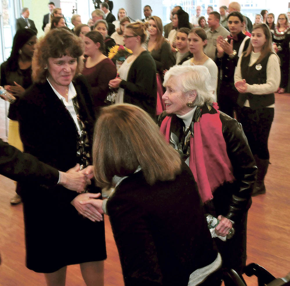 Thomas College President Laurie Lachance, left, Tuesday shakes hands with Margie Lunder Goldy, center, and Paula Lunder at Thomas College during a news conference announcing the Center for Innovation in Education. The Lunder Foundation contributed money toward the center.