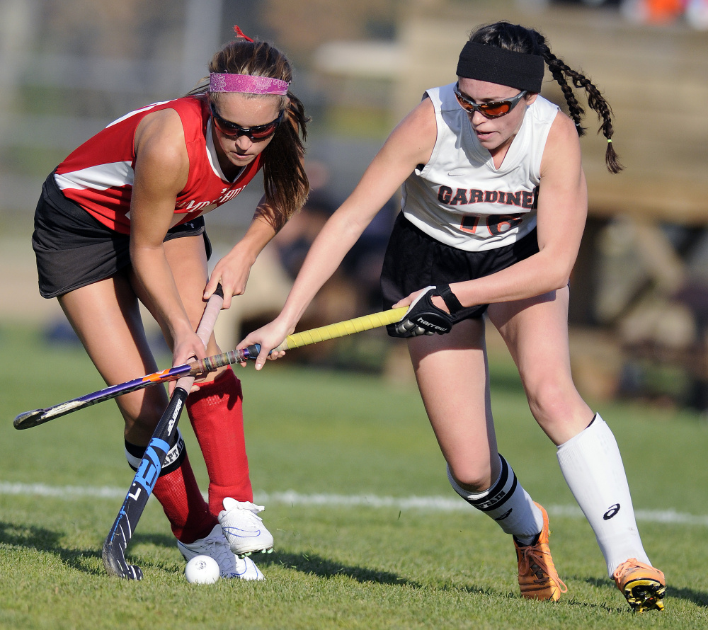 Gardiner Area High School's Bryce Smith, right, chases the ball with Camden Hills Regional High School's Emily Daggett during a Class B North quarterfinal game Tuesday in Gardiner.