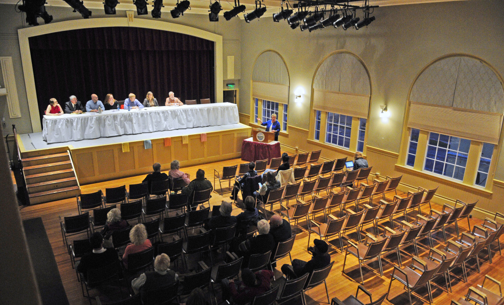 Charlotte Warren, center at podium, introduces candidates on stage at the start of a municipal candidates forum Tuesday at Hallowell City Hall.