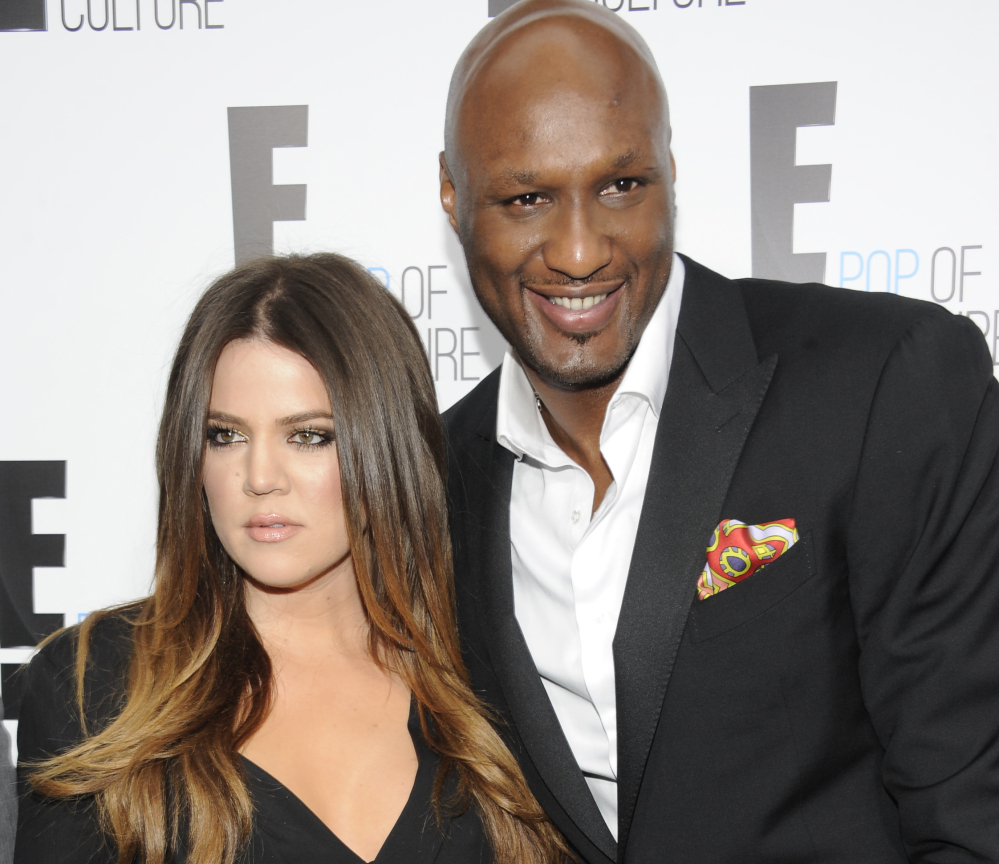 """In this April 30, 2012, file photo, Khloe Kardashian Odom and Lamar Odom from the show """"Keeping Up With The Kardashians"""" attend an E! Network upfront event at Gotham Hall in New York."""