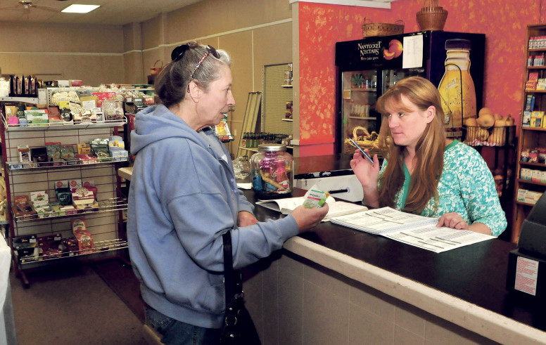 Ginny's store owner Ginny Jewell, right, waits on customer Irene Quirion at the new location at 78 Water St. in Skowhegan on Wednesday. Jewell was already moving out of Skowhegan Plaza, but a flood caused by torrential rain Sept. 30 moved the date up.