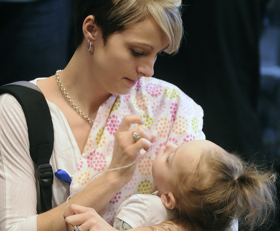 Jamie Davis, of New Sharon, clears the mouth of her daughter, Addilyn, before attending a hearing in April on a bill that would have put screening for Krabbe disease and similar disorders on the list of what's tested for in newborns in the state. Addilyn died Wednesday morning.