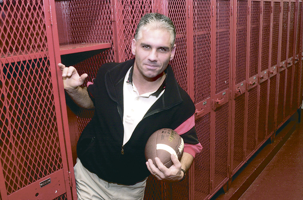 Staff file photo by Andy Molloy   This November 2000 file photo shows Tom Hinds, when he was named the Kennebec Journal Football Coach of the Year